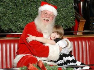 Vancouver Santa for hire girl hugging Santa