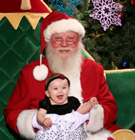 Vancouver Santa for hire posing with baby